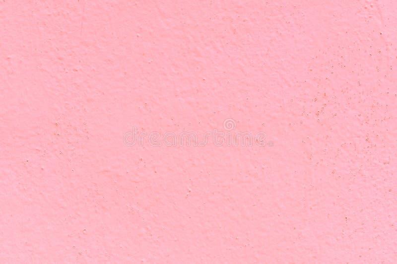 La texture du mur en béton est couverte de peinture à l'huile rose Grand fond pour tout usage photos stock