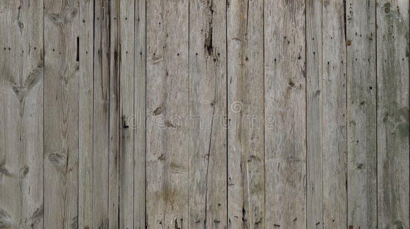 La texture du mur en bois superficiel par les agents Barrière en bois âgée de planche de conseil plat vertical images libres de droits