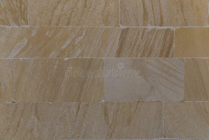La texture du mur garni des dalles en pierre photographie stock libre de droits