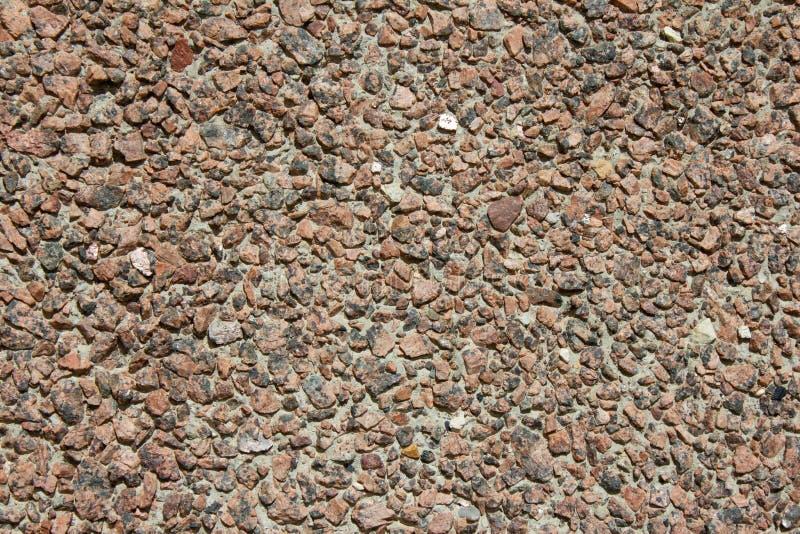 La texture du mur du plan rapproché de puces de granit photos libres de droits