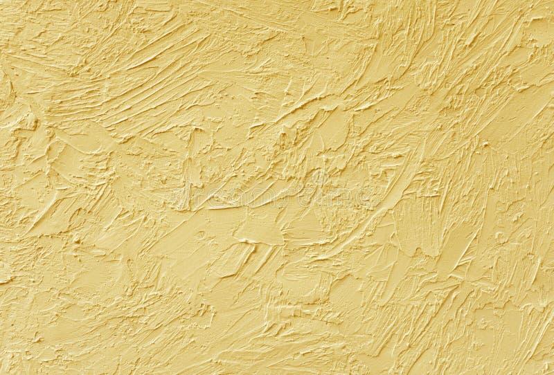 La texture du plâtre sur les murs est peinte dans le beige Fond photos libres de droits