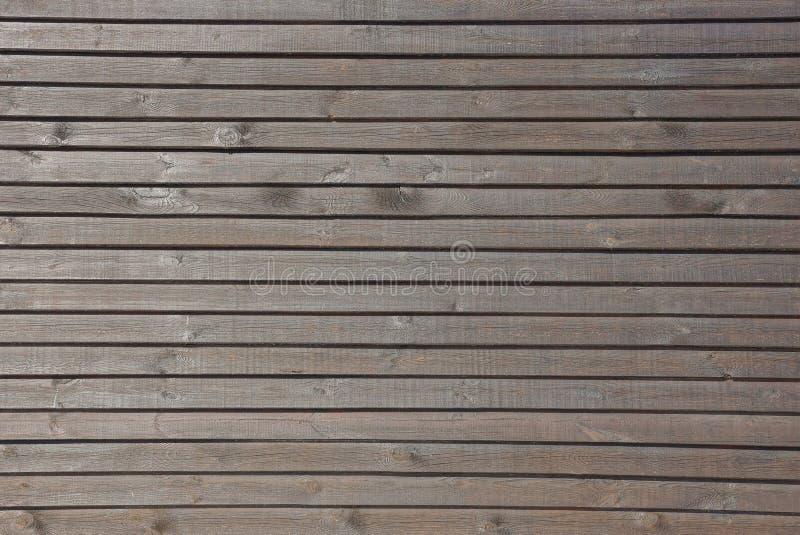 La texture en bois brune grise du mur mince embarque images libres de droits