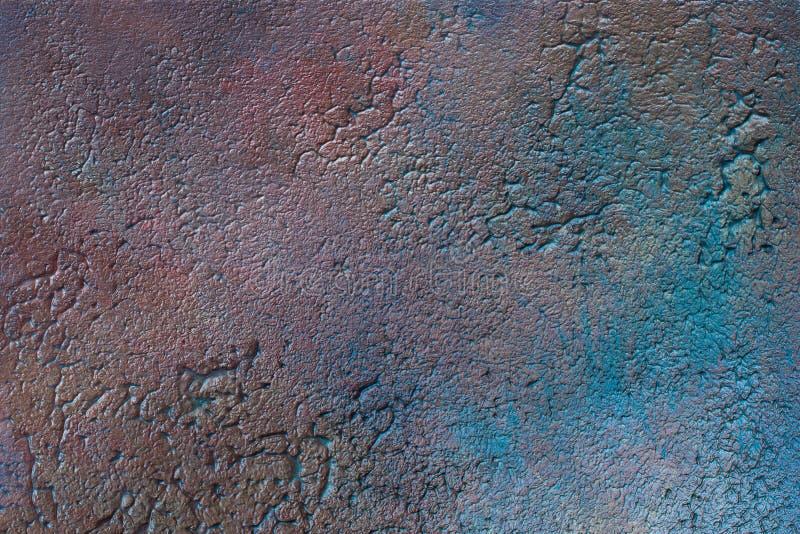 La texture lumineuse et colorée de la surface du plâtre dans le style d'un grenier, peut être employée comme fond matériel nature photo libre de droits