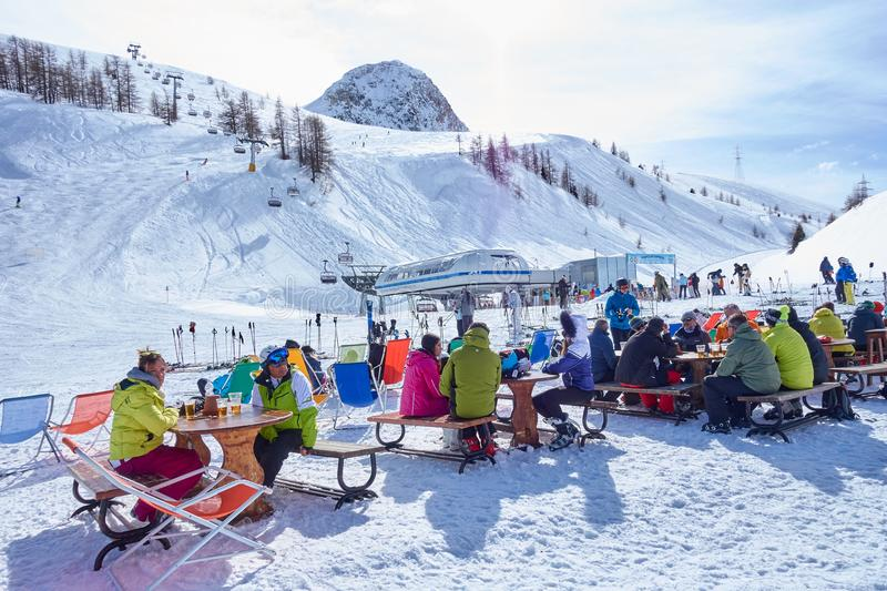 LA THUILE, ITALY - MARCH 4, 2018: Skiing on the San Bernardo Pas. S on 4 March 2018 in La Thuile, Italy. The San Bernardo Pass routes connect the ski areas in stock photos