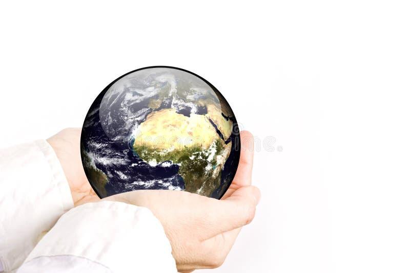 La tierra está en sus manos imagenes de archivo