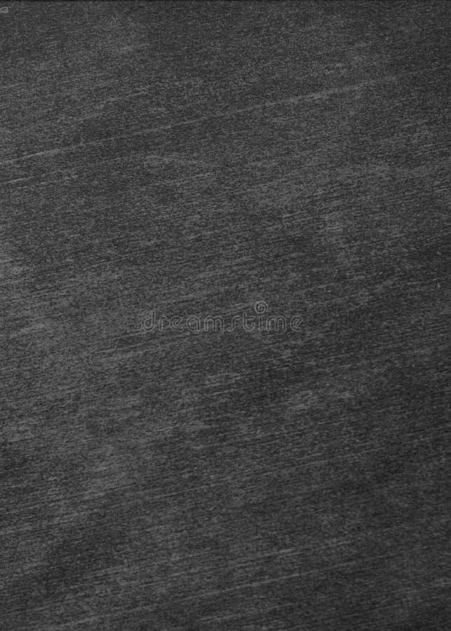 La tiza frot? hacia fuera en la pizarra para la textura del fondo para a?ade el texto o el dise?o gr?fico fotografía de archivo