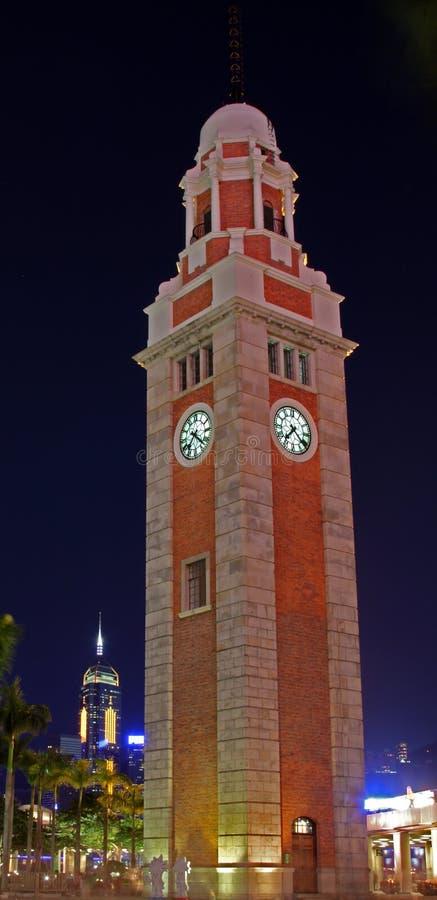 La torre de reloj, Hong-Kong (en la noche) foto de archivo