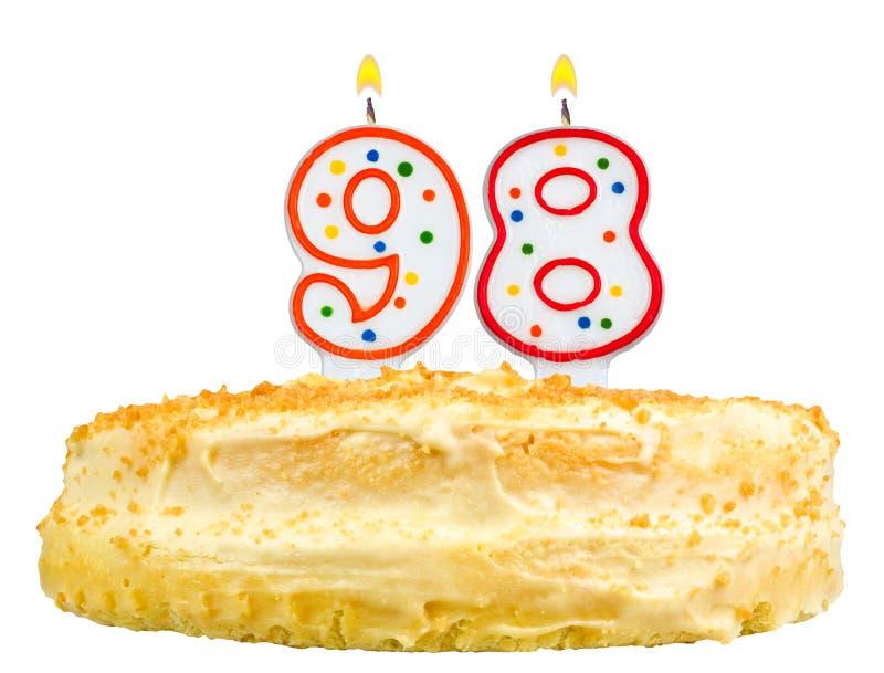 La torta de cumpleaños mira al trasluz el número noventa y ocho aislada fotografía de archivo