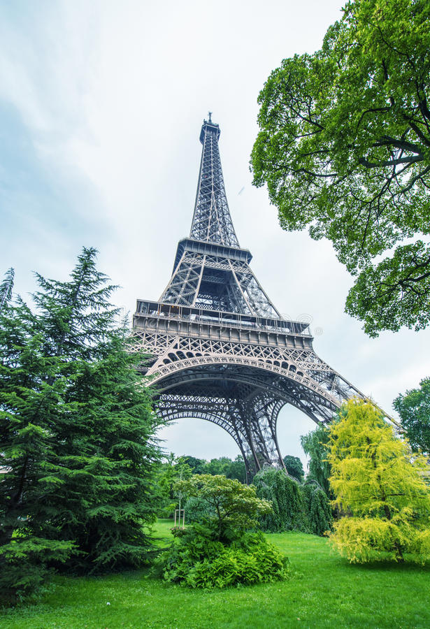 La Tour Eiffel in Paris surrounded by trees in summer royalty free stock photography