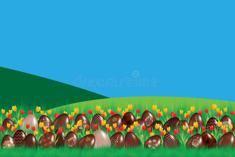 La tradición de los huevos de chocolate en Pascua en la hierba fotografía de archivo