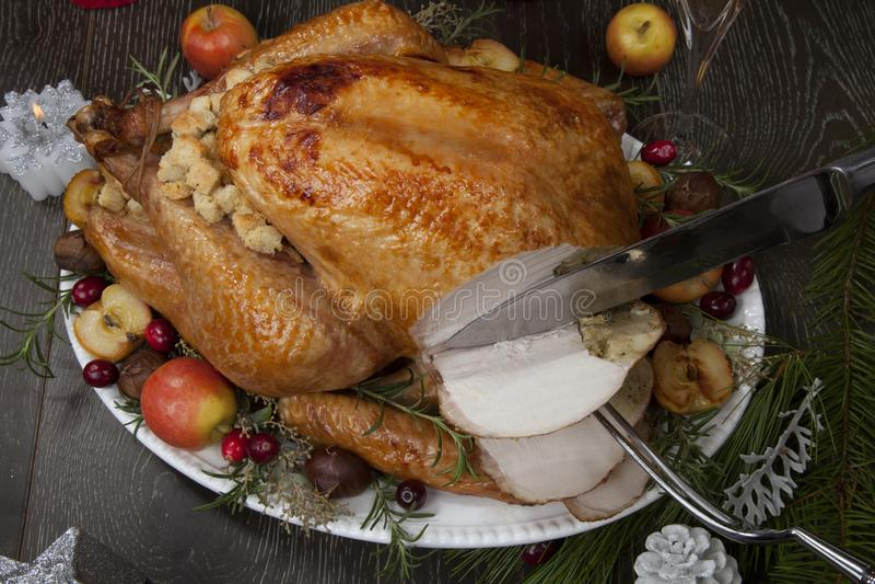 La Turquie de Noël rôtie aux pommes d'agneau photo stock