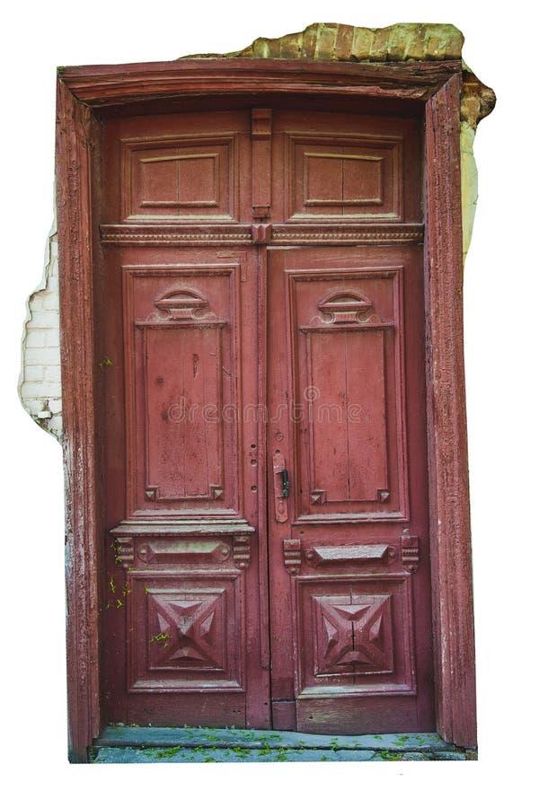 La vecchia annata ha distorto la porta di legno con i frammenti di gesso su un fondo bianco isolato immagini stock
