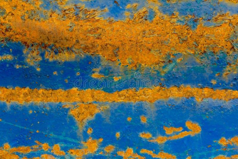 La vecchia struttura del metallo con la pelatura pittura e della ruggine blu fotografie stock