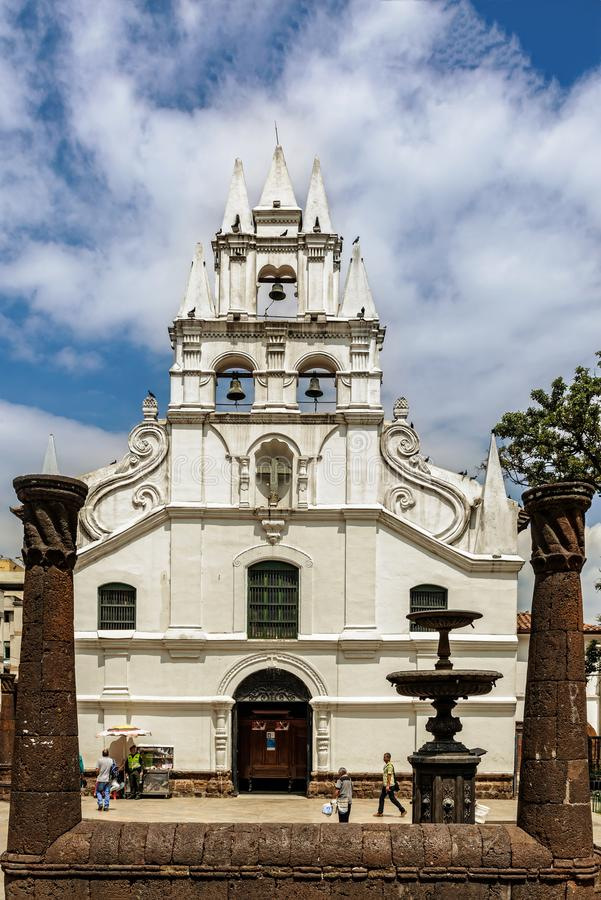 La Veracruz catholic church and the only colonial style church i. Medellin, Colombia, March 24, 2018: Locals, tourists walking by La Veracruz catholic church and royalty free stock photos