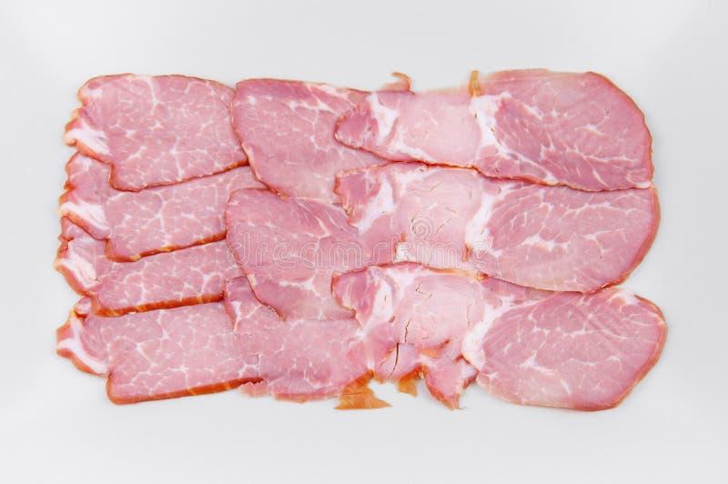 La viande a découpé en tranches dans une forme rectangulaire sur un fond clair photographie stock libre de droits