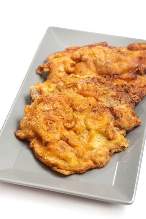 La viande de porc frite a servi du plat images stock