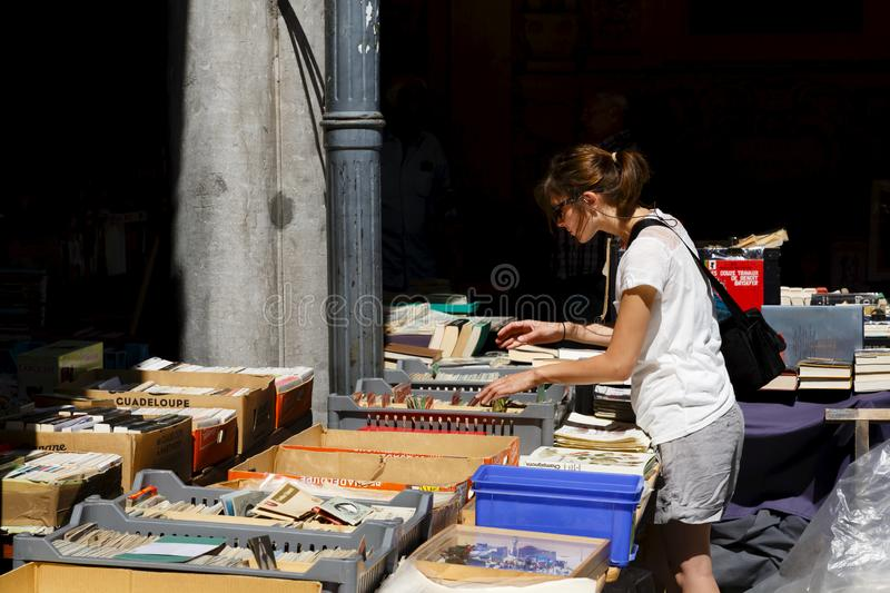 La Vieille Bourse de Lille. Lille, France - July 20, 2013. A woman browses at a book stall in La Vieille Bourse de Lille, the historic former stock exchange in stock photo