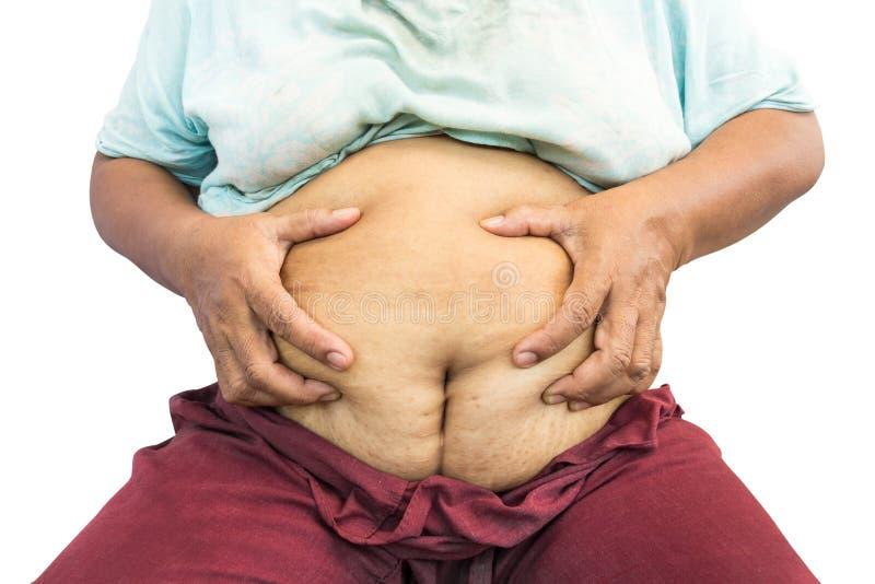 La vieille grosse femme asiatique saisissent son abdomen image libre de droits