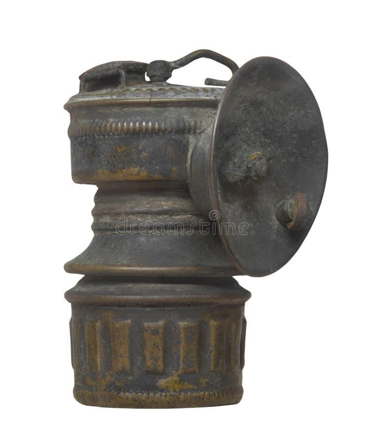 La vieille lampe du mineur d'isolement photographie stock libre de droits