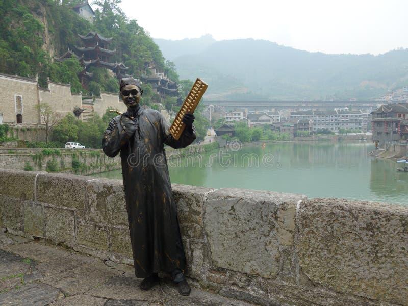 La ville antique de Zhenyuan pour prendre l'abaque en bronze photo stock