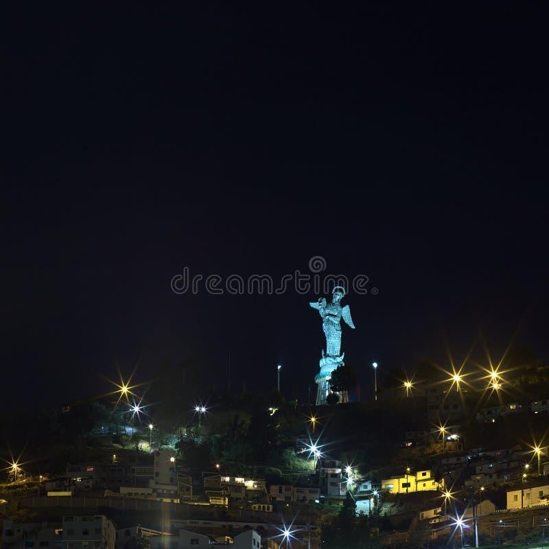 La Virgen de El Panecillo雕象在基多,厄瓜多尔在晚上 库存照片