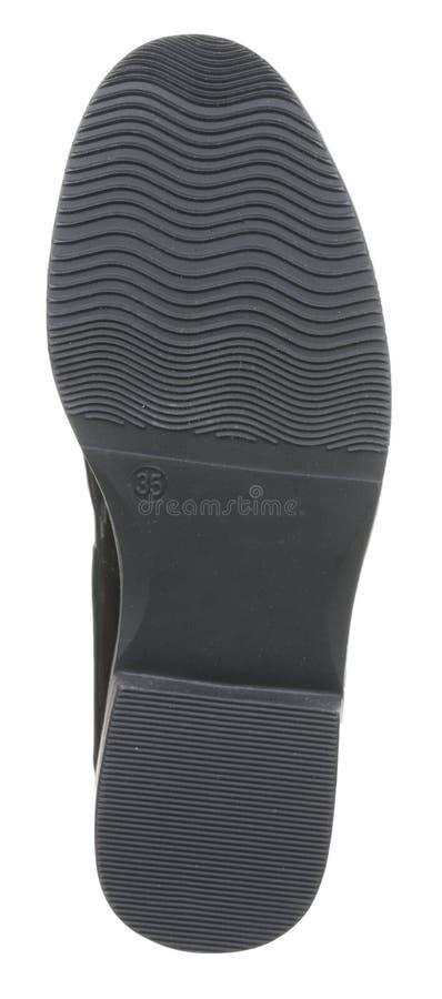 La vista inferior del negro barnizó la bota femenina de cuero del verano foto de archivo