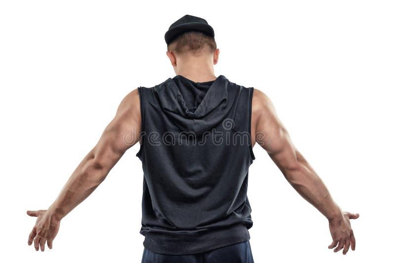 La vista posteriore di posa isolata dell'uomo di forma fisica e le manifestazioni armano i muscoli immagini stock libere da diritti