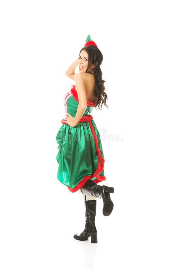 La vue arrière de l'elfe de port de femme vêtx le genou de recourbement images libres de droits
