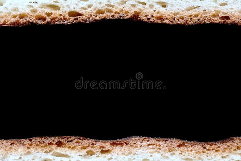 La vue de deux tranches de macro de pain blanc comme frontières a isolé l'ove photos stock