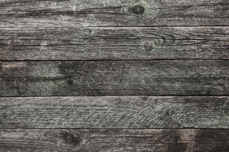 La vue supérieure et supérieure d'un gris-clair, temps a vieilli le fond en bois de tableau noir dans vieux photos libres de droits