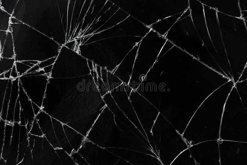 La vue supérieure a fendu le fond en verre de texture d'écran mobile cassé photo stock