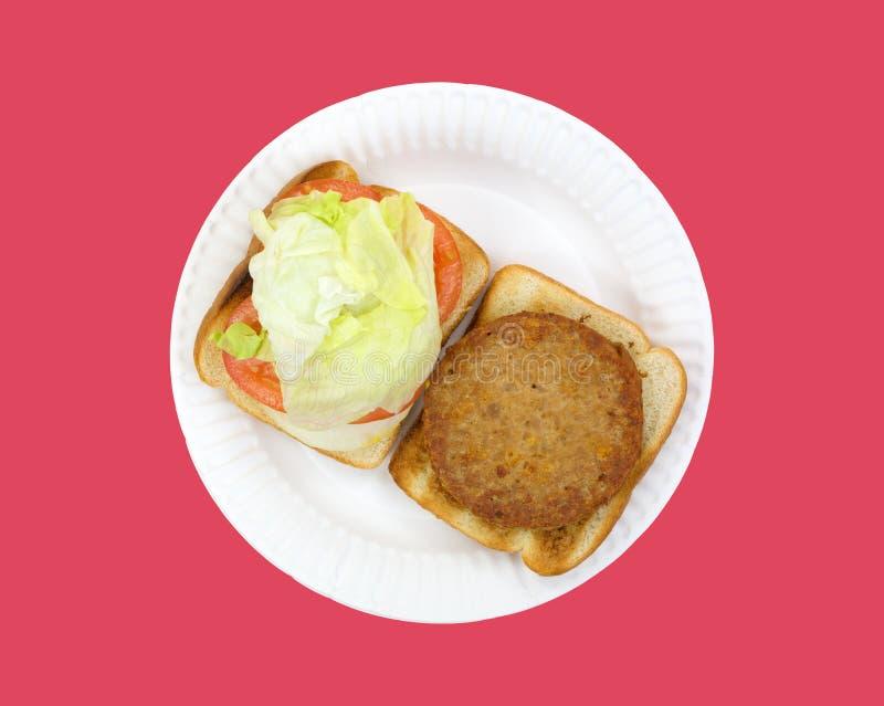 La vue supérieure ouverte a fait face à l'hamburger de veggie images stock