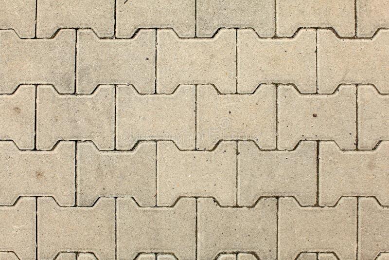 La vue supérieure sur la texture de plancher de pierre de ville s'est allumée par le soleil photographie stock