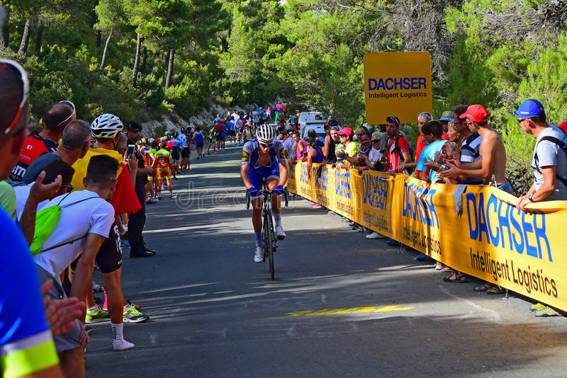 La Vuelta España Cycle Race. The crowd applauding the Quick Step Floors rider on a 20% hill in the 2017 La Vuelta Espana bike race royalty free stock photography