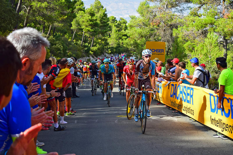 La Vuelta España Cycle Race Crowds Line A Steep Hill. The large crowd applauding the riders on a 20% hill in the 2017 La Vuelta Espana bike race royalty free stock images