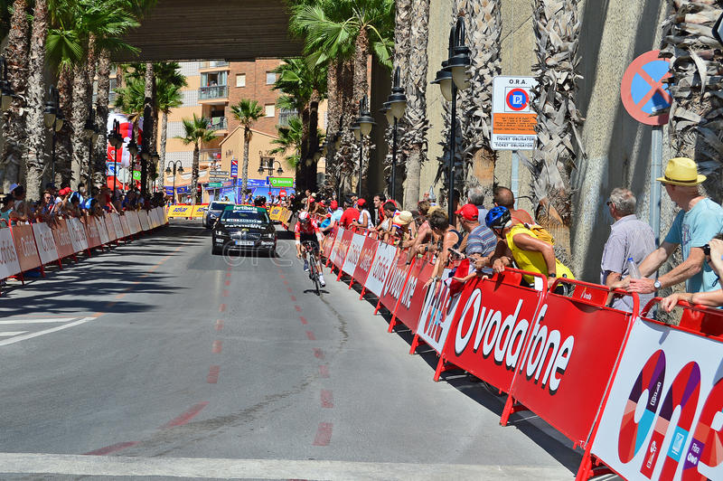 La Vuelta Espana Time Trial Lotto Soudal. The Lotto Soudal rider with leg and arm bandaged after an accident approaches the finish line of the time trial race stock photography