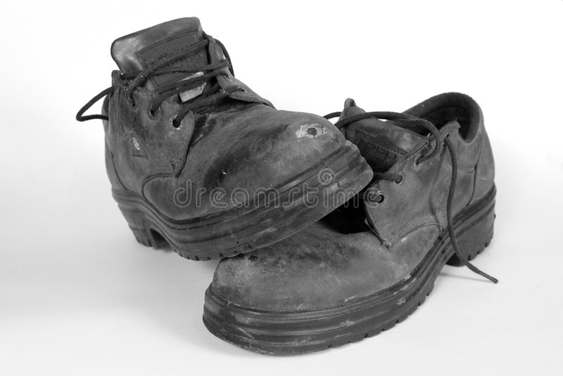 Laarzen 1 van het werk stock afbeelding