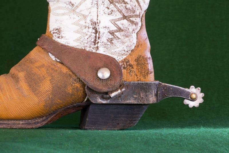 Laarzen en een aansporing royalty-vrije stock afbeeldingen