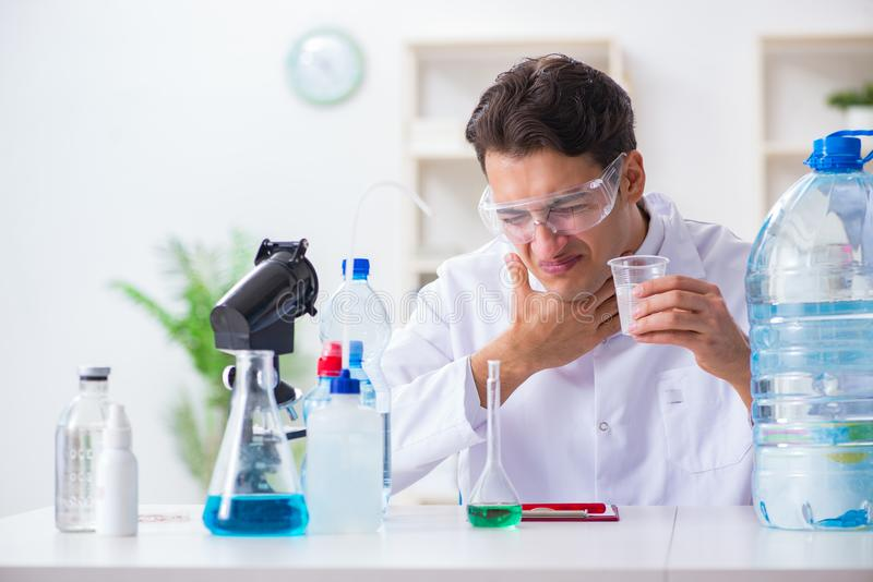 The lab assistant testing water quality stock photos
