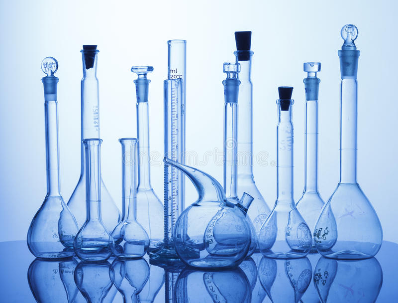 Lab assorted glassware equipment. Research Lab assorted Glassware Equipment on blue background royalty free stock photo