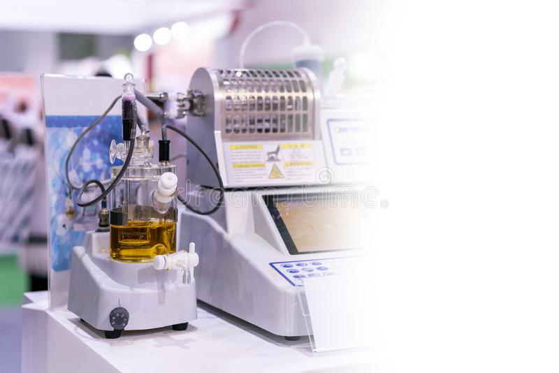 Lab equipment for analysis electrolysis reaction to find concentration of butter sugar and cheese paper. Coluometric titration device of lab for analysis stock images