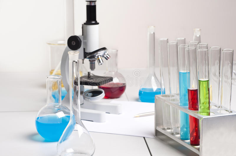 Lab flasks, tubes, microscope, lab workplace stock image