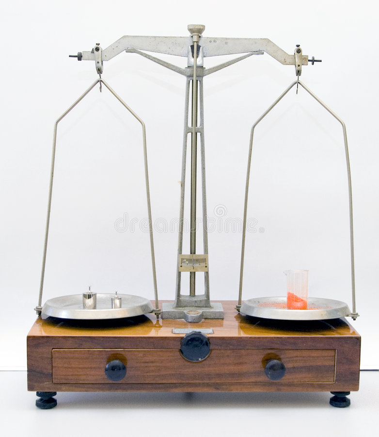 Lab old scale weighing. An old style weighing machine in a lab, weighing some red powder stock photos