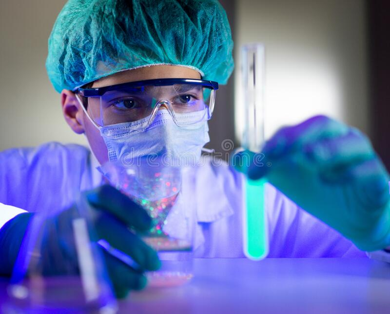 Lab scientist working on viruses tube samples stock photography