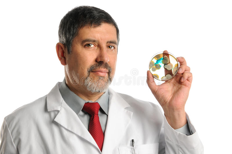 Download Lab Technician Showing Petri Dish With Bacteria Stock Photo - Image: 26910060