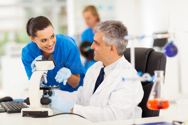Lab technicians working. Group of lab technicians working in laboratory royalty free stock photos