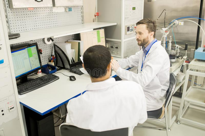 Lab Technicians Wrapped up in Work stock photo