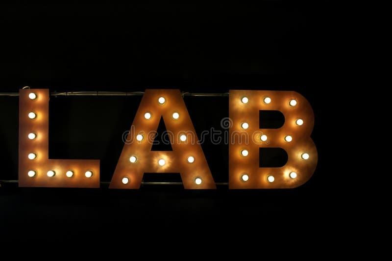 Lab writing robić na żarówkach obok wyłaczający obraz royalty free