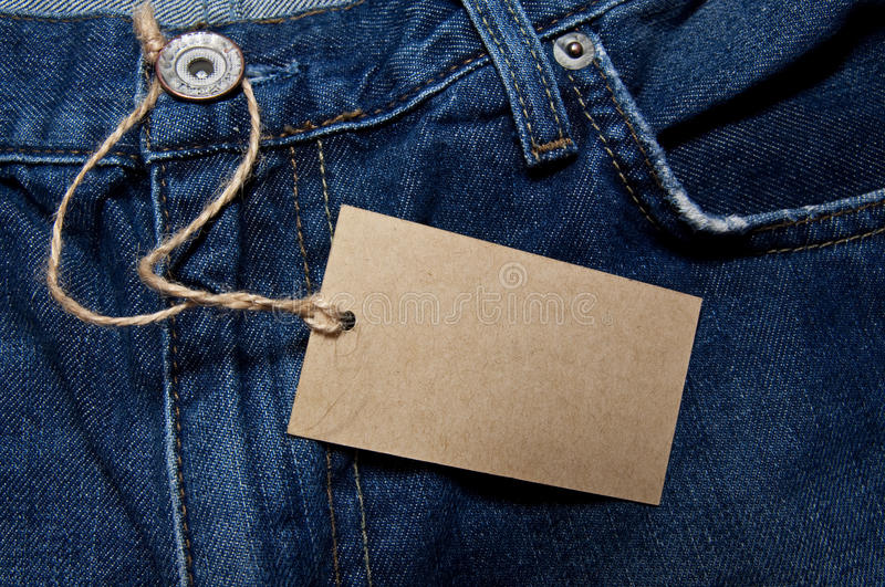 Label. On dark blue jeans royalty free stock photography