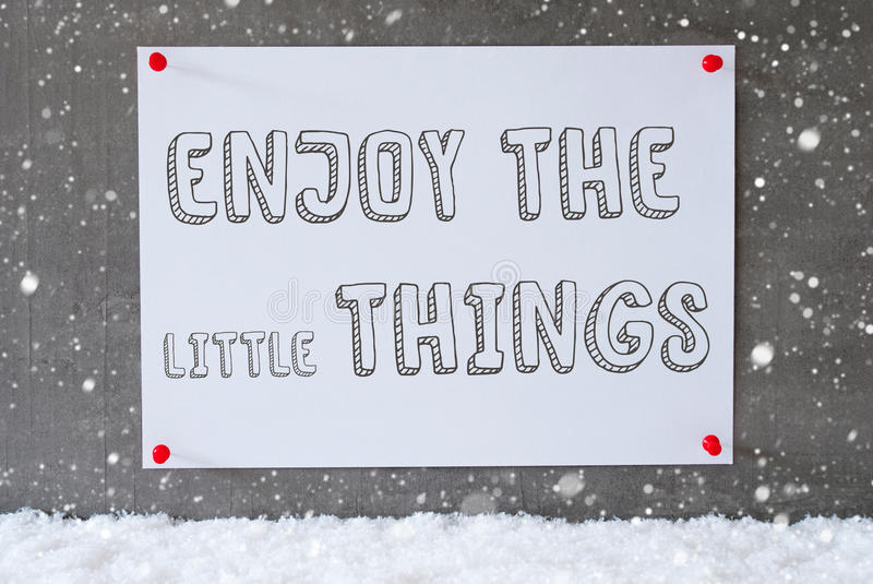 Charming Download Label On Cement Wall, Snowflakes, Quote Enjoy The Little Things  Stock Photo